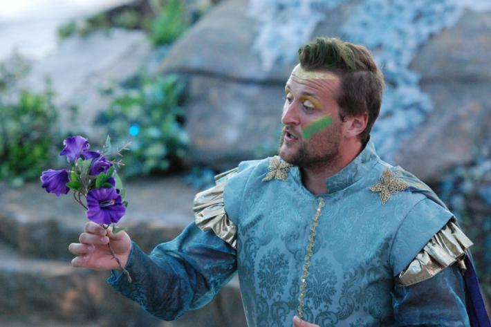 Oberon, King of the fairies, holding a purple flower in Britten's opera, A Midsummer Night's Dream