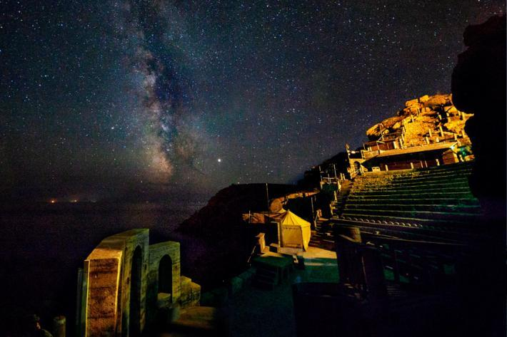 Minack by night with the Milky Way arcing across the sky