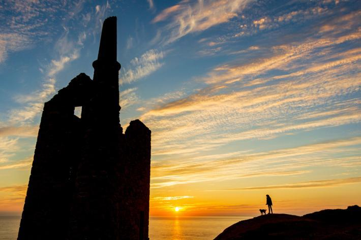 Silhouette of mine stacks at Botallack, at sunset