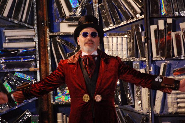 A magician welcomes you to a glittering archive