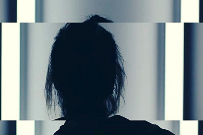 Silhouette of a woman slightly distorted