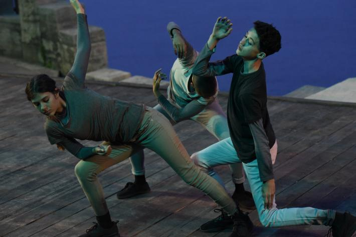 Three teenage dancers as spirits of the underworld in Monteverdi's opera Orfeo
