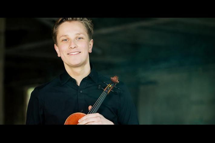 Portrait of a young man holding a violin