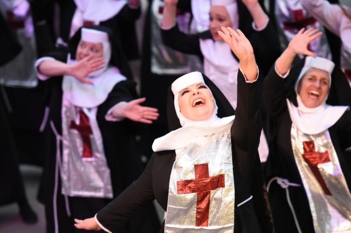 Wildly dancing nuns in sparkly habits