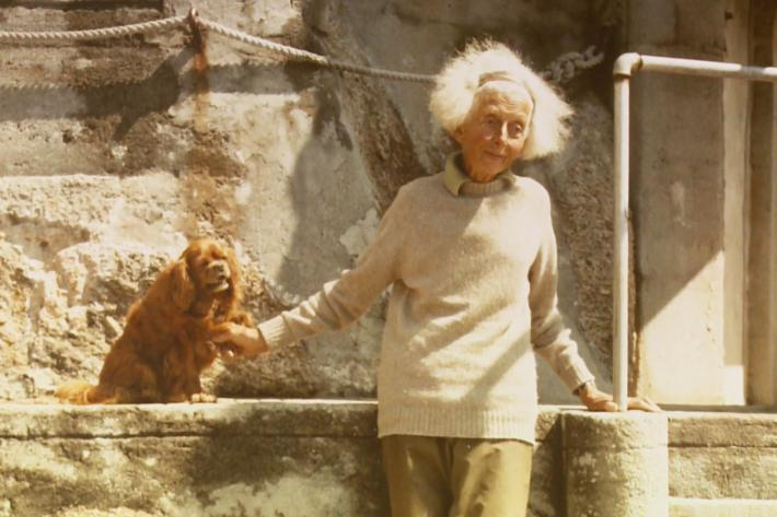 Rowena Cade in the theatre with one of her spaniels