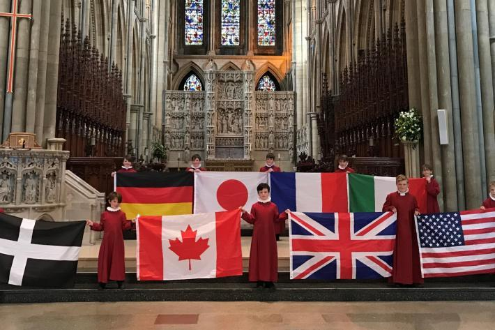 Choirboys with G7 national flags