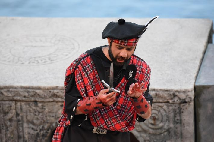 Macbeth with bloodstained hands and a dagger