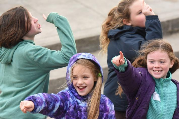 Four young girls taking part in an acting workshop on the Minack stage