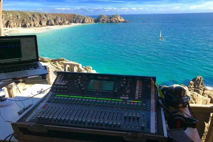 A sound operators view from the sound shed on a sunny afternoon, looking across Porthcurno Bay