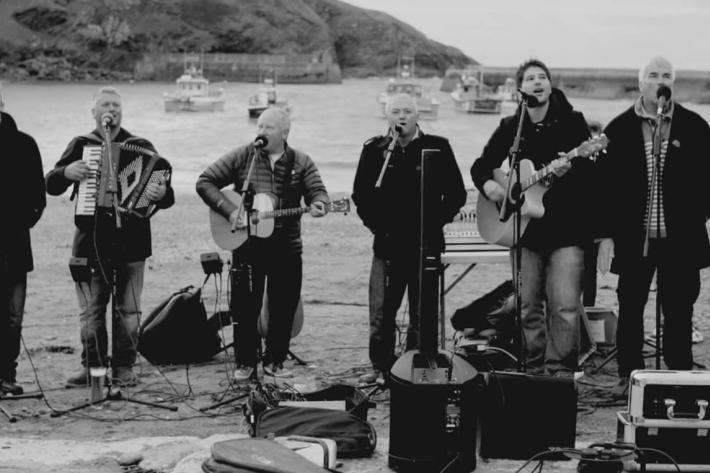 The Fisherman's Friends performing on the platt at Port Isaac