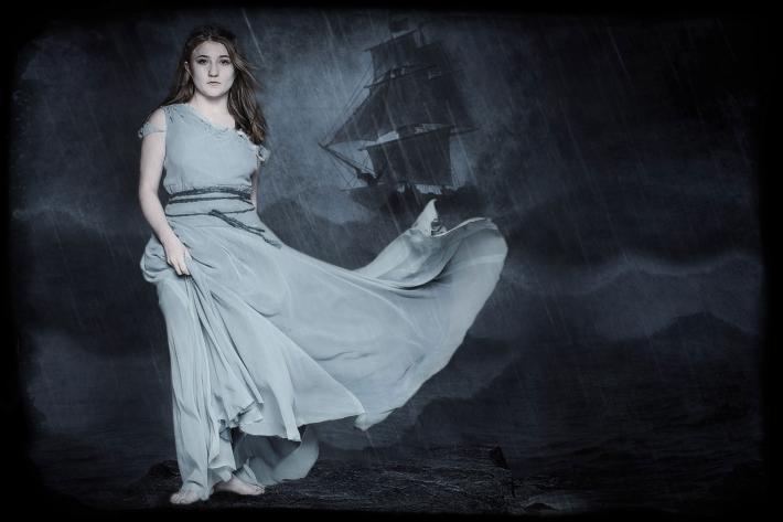 Atmospheric image of Miranda and a sailing ship