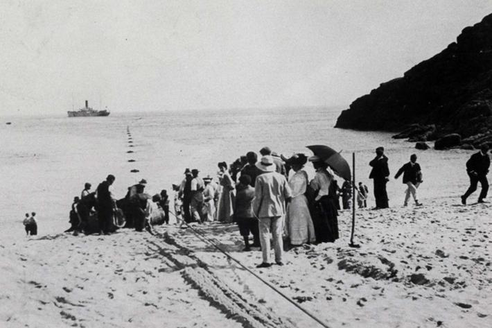 A cable coming ashore at Porthcurno in 1906